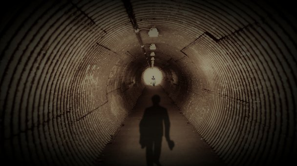 Silhouette of a man and light in the tunnel
