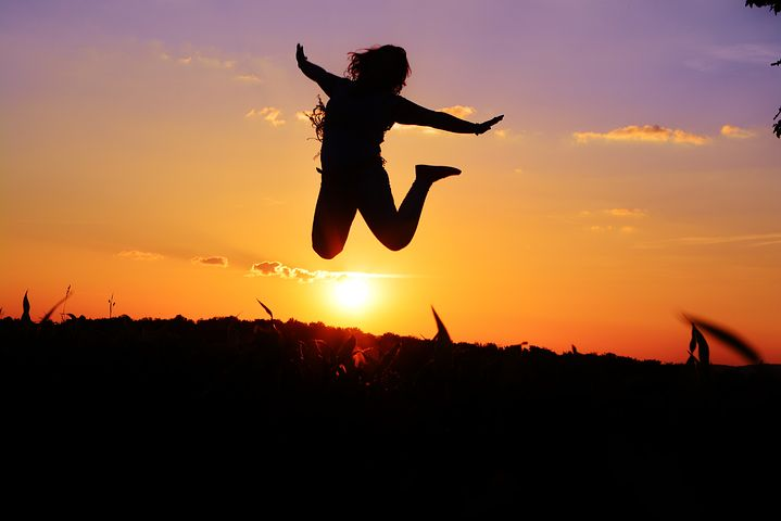 Silhouette of a woman leaping with Joy